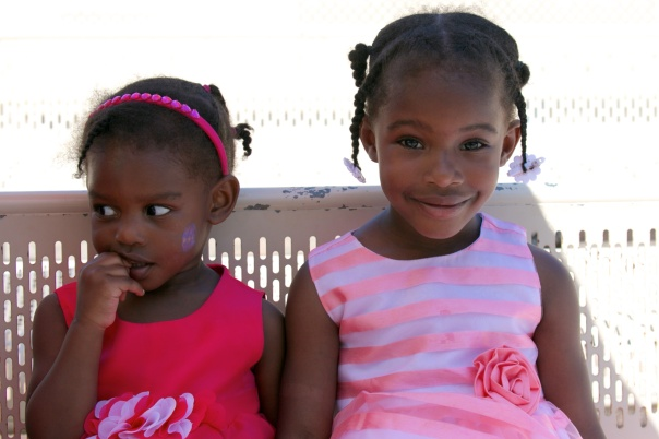 3P8C7723.jpg Shy Nala and big sister Kaylence, in their Easter dresses, await the start of the concert
